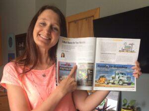 Monica holding up APE Magazine
