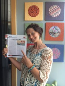 Monica with the published article.
