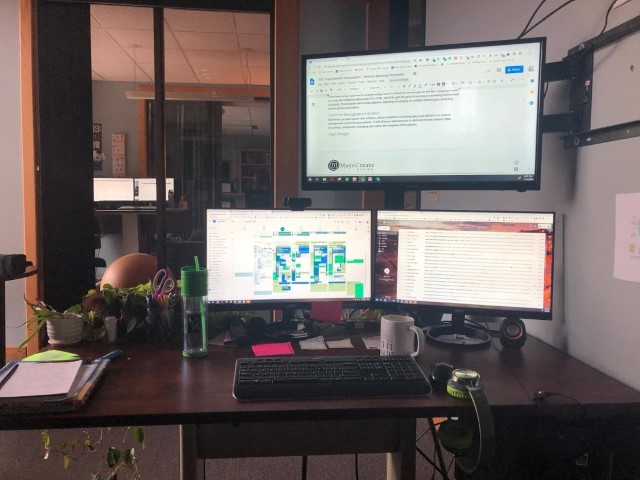 Erika's sweet new office setup with three monitors (one is a TV)