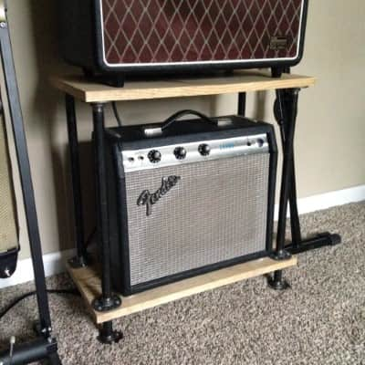 A floor shelf built by Jacob, holding his amp.