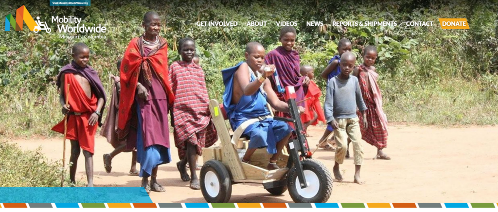 image from Mobility Worldwide-Columbia website - children with boy on cart