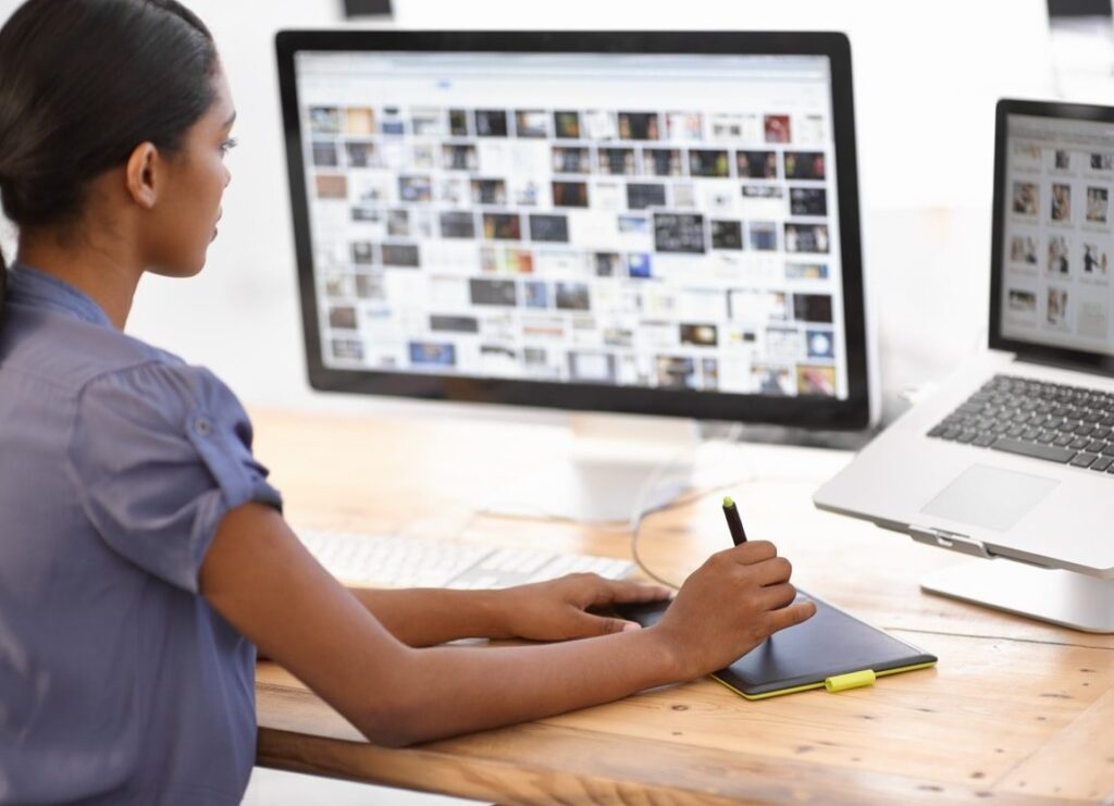woman selecting images from her computer